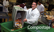 An employee sorting food scraps the support the composting program.