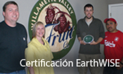 Employees holding an EarthWISE plaque.