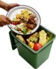 Image of food waste being scraped into a kitchen compost bucket