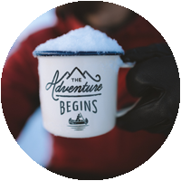 adventure begins here mug with snow on top